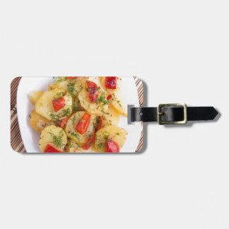 Top view of the pieces of potato stew with vegetab luggage tag