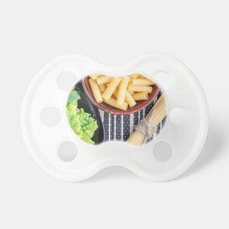 Top view of the spaghetti, pasta and lettuce pacifier
