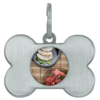 Top view of the table with a home-cooked meal pet name tag