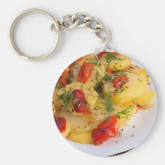 Top view of the vegetarian dish of organic potato keychain