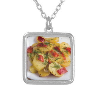 Top view of the vegetarian dish of organic silver plated necklace