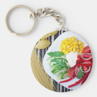 Top view of the vegetarian dish of raw vegetables basic round button keychain