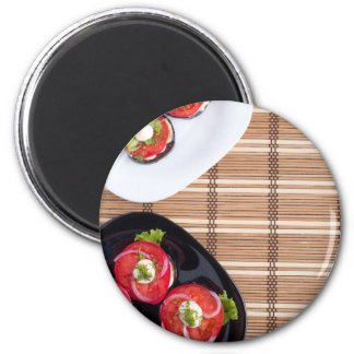 Top view of the vegetarian dishes stewed eggplant 2 inch round magnet