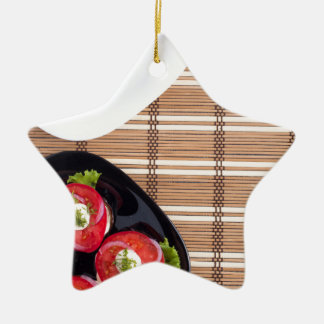 Top view of the vegetarian dishes stewed eggplant ceramic star ornament