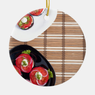 Top view of the vegetarian dishes stewed eggplant round ceramic ornament
