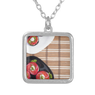 Top view of the vegetarian dishes stewed eggplant silver plated necklace