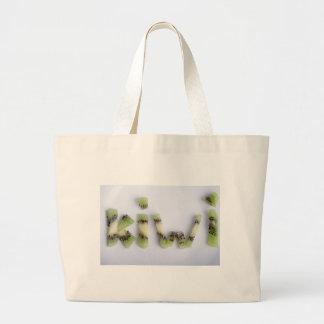 Top view of the word kiwi closeup large tote bag