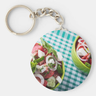Top view of two bowls useful vegetarian meal close basic round button keychain