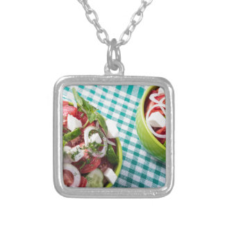 Top view of two bowls useful vegetarian meal close silver plated necklace