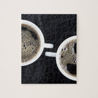 Top view of two small cups of coffee jigsaw puzzle