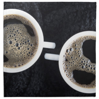Top view of two small cups of coffee napkin