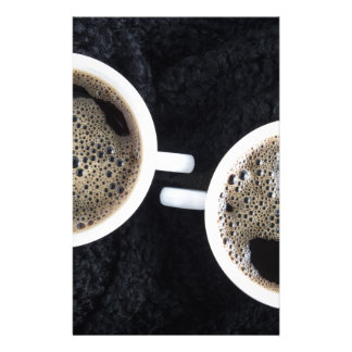 Top view of two small cups of coffee stationery