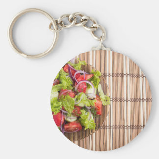 Top view of vegetarian salad from fresh vegetables basic round button keychain