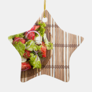 Top view of vegetarian salad from fresh vegetables ceramic star ornament