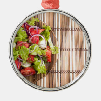 Top view of vegetarian salad from fresh vegetables Silver-Colored round ornament