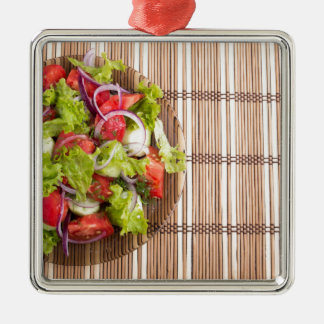 Top view of vegetarian salad from fresh vegetables Silver-Colored square ornament