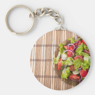 Top view of vegetarian salad on a bamboo mat basic round button keychain