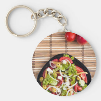 Top view on a fresh vegetable salad with natural basic round button keychain