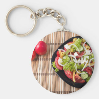 Top view on a healthy and natural vegetable salad basic round button keychain