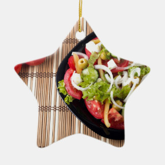 Top view on a healthy and natural vegetable salad ceramic star ornament