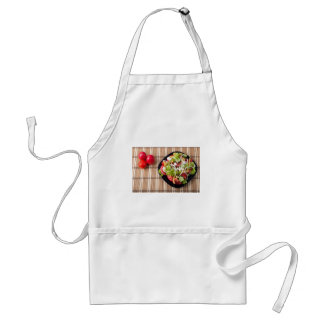 Top view on a healthy and natural vegetable salad standard apron