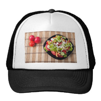 Top view on a healthy and natural vegetable salad trucker hat