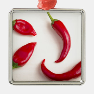 Top view on a hot red chili peppers Silver-Colored square ornament