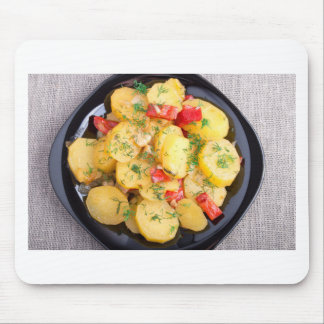 Top view on a stew of potatoes with pepper mouse pad