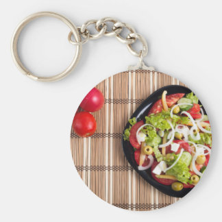 Top view on a vegetable salad with natural basic round button keychain