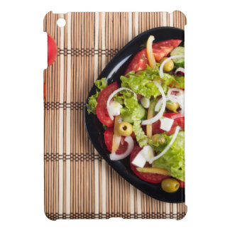 Top view on a vegetable salad with natural case for the iPad mini