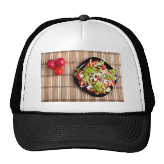 Top view on a vegetable salad with natural trucker hat
