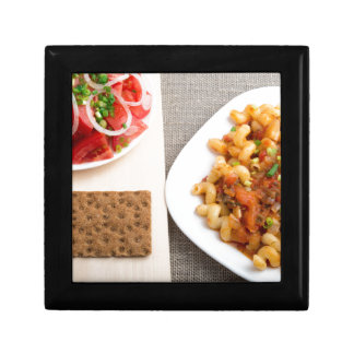 Top view on Cavatappi Pasta on textile background Gift Box