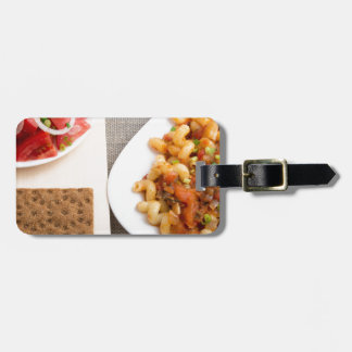 Top view on Cavatappi Pasta on textile background Luggage Tag