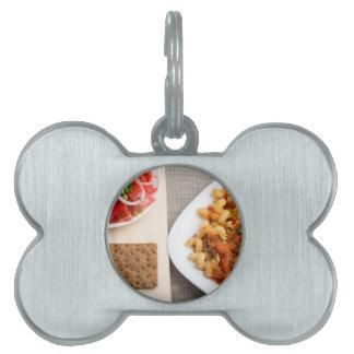 Top view on Cavatappi Pasta on textile background Pet Name Tag