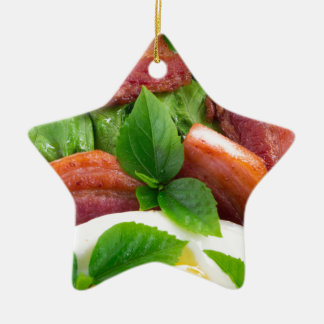 Top view on egg yolk, fried bacon and herbs ceramic star ornament