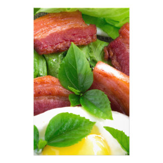 Top view on egg yolk, fried bacon and herbs customized stationery