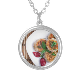 Top view on food made from natural ingredients silver plated necklace