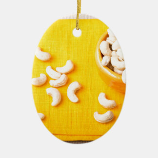 Top view on natural and healthy cashews ceramic oval ornament