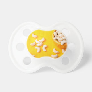 Top view on natural and healthy cashews pacifier