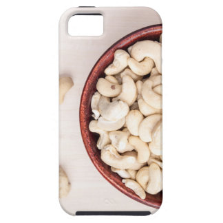 Top view on raw cashew nuts for vegetarian food iPhone 5 case