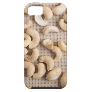 Top view on raw cashew nuts scattered on the table case for the iPhone 5