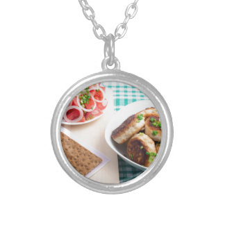Top view on russian homemade lunch on a table silver plated necklace