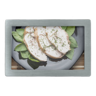Top view with baked slices of chicken meat rectangular belt buckle