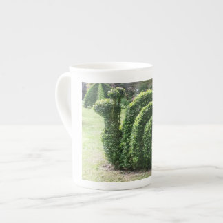 Topiary garden snail trendy clipped bush tea cup