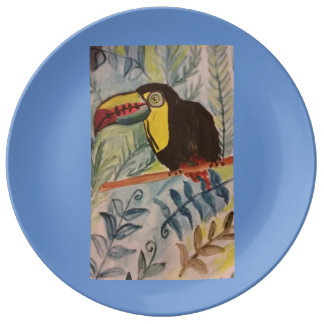 Toucan with tropical theme. plate