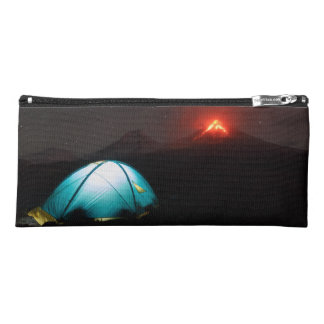 Tourist tent at night on background of volcano pencil case