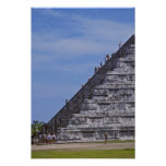 Tourists climbing stairs on ruins of El Poster