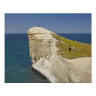 Tourists on cliff top at Tunnel Beach Poster