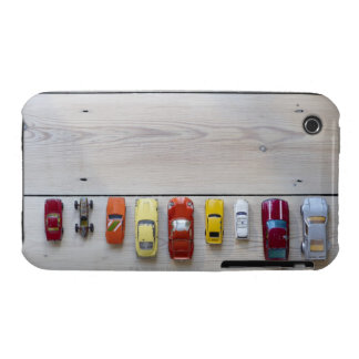 Toy cars lined up in a row on floor iPhone 3 covers
