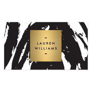 Traçages noirs abstraits avec le logo de nom d or cartes de visite personnelles